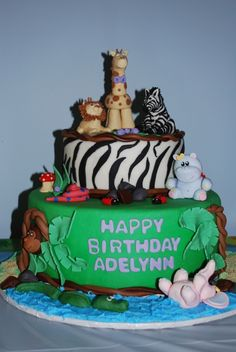 Another jungle cake.    Previous pin:  Green bottom with zebra top? Very cute... Oh, and the fondant giraffe is adorable.