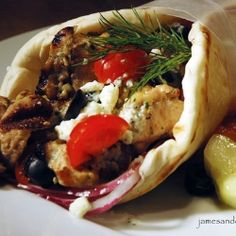 Greek Chicken Sandwich (Gyros With Tzatziki Sauce) - Tender pieces of chicken thigh, marinated in olive oil, lemon juice and Greek spices, served in a warmed pita bread with onion, black olives (1) From: James And Everett, please visit