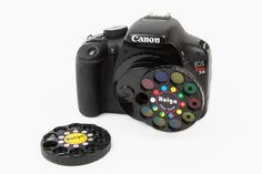 DSLR+Wheel+of+Filters+-+Eighteen+filters+and+prismatic+lenses+for+your+DSLR+are+just+a+twist+away.+($40.00,+http://photojojo.com/store)