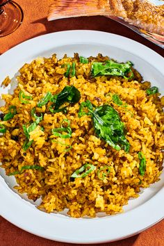 Paul Carmichael's Curried Rice Recipe - NYT Cooking Rice Recipes, Indian Food Recipes, Vegetarian Recipes, Cooking Recipes, Haitian Recipes, Savoury Recipes, Donut Recipes, Baked Rice, Lamb Curry