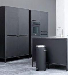 Dark cabinets, concrete flooring