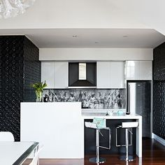 This compact kitchen is packed with character with textured wall covering and a  bespoke patterned glass splashback. http://www.housetohome.co.uk/kitchen/picture/black-and-white-kitchen-with-glass-splashback#u78gGySGsMiEOf8x.32