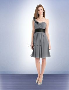 This beautiful one shouldered dress features rosette embellishments and a stunning satin waistband!