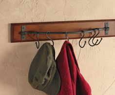 Instead of protruding six fixed wall hooks at all times (even when they're not in use), this equestrian-inspired rack features ring-adjustable hooks that slide along a metal bar.