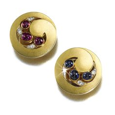 ROMANOV HEIRLOOMS: THE LOST INHERITANCE OF GRAND DUCHESS MARIA PAVLOVNA: A pair of jewelled gold cufflinks, Vladimir Finikov, St Petersburg, circa 1880, set with swirls of diamonds, cabochon sapphires and cabochon rubies.