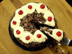 easy eggless black forest cake with step by step photo/video. layered dessert baking delicacy chocolate sponge cake sandwiched with cherries & whipped cream