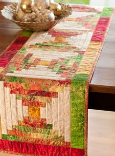 Create five Courthouse Steps blocks in cheery holiday colors for a special seasonal table runner.