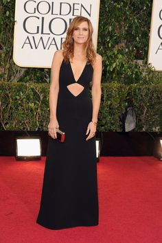 Kristen Wiig stepped things up in a cutout Michael Kors wool crepe halter gown with a mirrored box clutch.  Golden Globes Red Carpet Pictures 2013