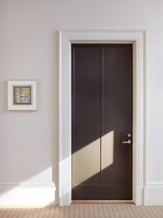 An entry door at 160 West 12th Street, part of the Greenwich Lane, designed by Thomas O'Brien and Aero. Photography by Pieter Estersohn.