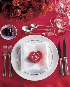 This Valentine's Day wedding had red tablecloths with monogrammed heart-shaped boxes of chocolates and saucers of candy.