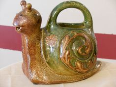 A Snail Pottery Watering Can