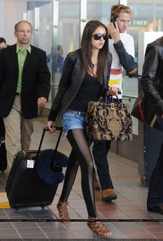 Nina Dobrev Style - Black tee, jean skirt, black leggings and leather jacket.