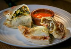 A Super Kale Empanada, left, and an Argentine Beef Empanada with Chipotle Salsa at Venga Empanadas in San Francisco. Photo: John Storey, Special To The Chronicle