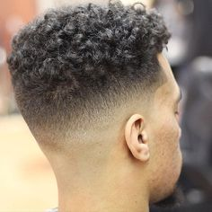 barberjuan94_and mid skin fade and curly hair on top