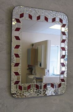 Made by seller Made on MDF Backer board. This one Is made using hand cut red stain glass & mirror forming the main pattern as in the picture. and hand chipped mirror mosaics . Finished in white grout and black edge. size x Centre mirror x Ready to