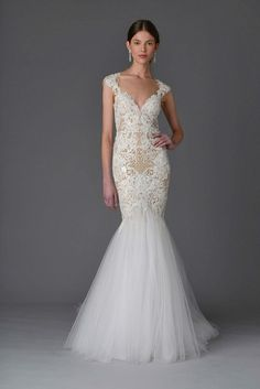Stunning mermaid gown with beautiful embroidery.