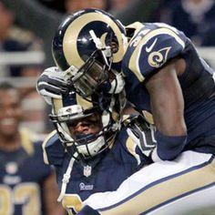 St. Louis Rams defensive end Michael Sam gets his first sack