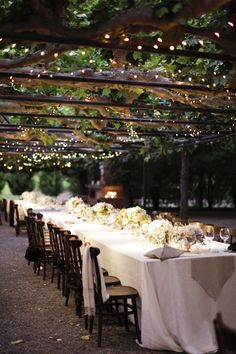I'm thinking outdoor reception, maybe in a tent? with lights like this overhead with paper lanterns, too