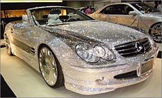D.A.D. LS-Edition Mercedes Benz SL600 Covered entirely of Swarovski crystals   So, I love   BLING but this is a little extreme.   WOW!!!