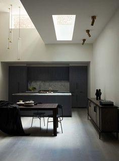a dark kitchen with skylights