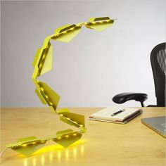 Trask Lamp is a very interesting laser-cut LED light that can be sculpted into a desk lamp, a task lamp or a tracking lamp.