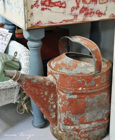 I am just crazy about watering cans - old, chippy, rusty, dented - i love 'em all!