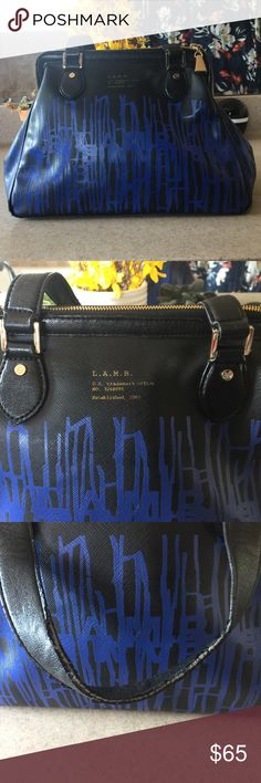 L.A.M.B. Handbag Great Handbag from Lamb. This purse has been used and show some signs of wear. The corners are edged (pictures) and handles have some wear (pictures). Inside has some stains. Is a little dirty, but after cleaning it looks great. Only clean with water and dust cloth. Priced to sell!! L.A.M.B. Bags Shoulder Bags