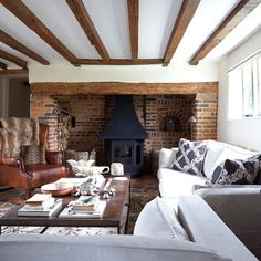 white ceiling and walls and strip the beams back to lighter wood