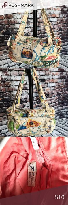 Fossil handbag. Fossil canvas material small handbag.  Gently used no rips or stains. Measures at about 5in wide by 7 inches tall by 3in deep. Fossil Bags Mini Bags