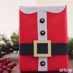 Here's a DIY gift wrap idea that puts the ho-ho-ho in the holidays. The gift box resembles Santa's red suit, complete with collar and belt. It just may be the best-dressed gift under the tree this season. Diy Christmas Gifts Videos, Christmas Gift Wrapping, Christmas Projects, All Things Christmas, Holiday Crafts, Holiday Fun, Wooden Christmas Decorations, Santa Suits, Creative Gift Wrapping