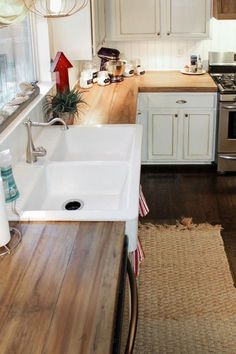 Wood counters, white cabinets, farmhouse sink