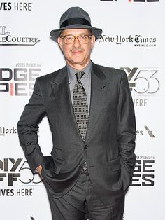 Tom Hanks accessorized a dapper gray suit with a matching old school-inspired hat 'n' translucent caramel-colored specs!