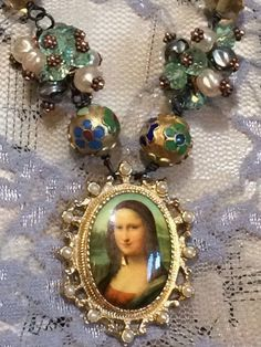 A personal favorite from my Etsy shop https://www.etsy.com/listing/488395044/mona-lisa-crystal-glass-pearl-enamel