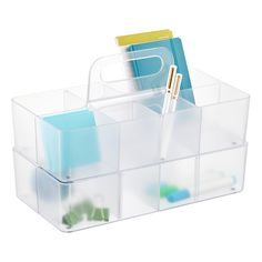 Our Supply Caddy is ideal for toting and storing art and office supplies or even as a silverware caddy. The handle makes it easy to grab off a shelf or desk and is designed to slide into the middle so multiples can be stacked. And it features three removable dividers allowing you to customize your storage space and create up to eight sections.