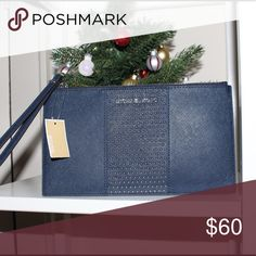 Michael Kors Saffiano Leather Studded Wristlet LG NWT micro studded clutch wristley in beautiful navy color brand new with tag. 100% authentic Michael Kors Bags Clutches & Wristlets