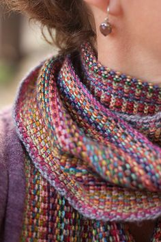 """...o think of this as Missoni-esque rather than clown barf.  I cast on 600 stitches, and <span class=""""best-highlight"""">knitted through the back loops at the beginning and end of every row leaving a short length of yarn. I then pulled the yarn tightly to create a</span> self-fringe. I did one row only per colour (which took 6-7 yards of yarn).  I ended up doing 82 rows and the scarf..."""