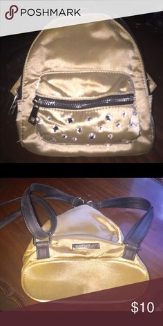 """d52e07bab8a9 Steve Madden Small Backpack Small plaque on bag that says Madden Girl. Color   Gold Approximately 8"""" X 10"""" Zipper pocket on the outside Two small pockets  ..."""