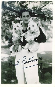 0 Basil Rathbone holding 2 terriers - autograph