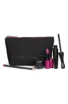 - M·A·C Look in a Box Girl Band Glam kit features a selection of purple-toned products designed to let loose the rocker in you. It comes with a zip-top pouch perfect for stashing makeup in for quick t