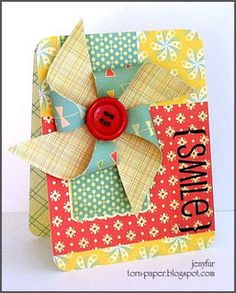 Oh for the love...I adore this pinwheel! And the colors and patterns...and the button!