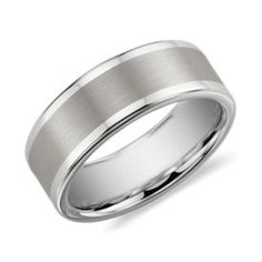 This contemporary wedding band for him features a 16 carat Jared