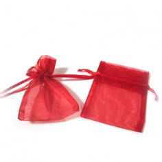 """Red Organza Bags (Set of 10)   Nuptial Knick Knacks    Available is five popular sizes, our bags are made of high quality organza sheer, with a satin drawstrings. Our organza bags have a wide range of use for your bridal needs. They work great for bridesmaids' and guest gift packaging as well as candies and almonds. Choose from 5 different sizes:  3"""" x 4"""", 4"""" x 6"""", 5"""" x 7"""", 6"""" x 10"""" and 6.5"""" x 15""""(Perfect for wine and liquer bottles)"""