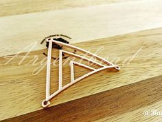 Check out this item in my Etsy shop https://www.etsy.com/uk/listing/290485327/1-pc-of-55x47mm-pink-rose-gold-triangle