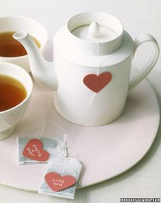 add hearts to tea bag strings to personalize ... cute idea for a tea party/shower
