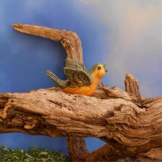 Tweet! Get your miniature garden displays singing with our tiny miniature bird figurine. This detailed miniature orange bird is the perfect garden accessory.