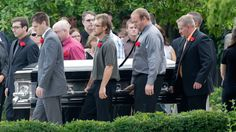 Pallbearers carry Matt McQuinn, killed in the Aurora, Colorado movie theatre shooting, from the church after his funeral in Springfield, Ohio, on Saturday, July 28, 2012. (AP /Jay LaPrete)
