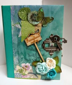Fairy Garden Mini Album created by Kelly Brandt. For more details check out: http://southernchipboard.blogspot.ca/2014/08/fairy-garden-mini-album_26.html. To order this amazing chipboard check out: www.chipboard.ca