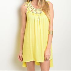 ✨NEW✨Bright Yellow Tribal Tassel Embroidered Dress Tank style, embroidered collar sunny yellow dress with an asymmetrical hemline. Available in S M L. PLEASE ASK FOR A SEPARATE LISTING. Dresses