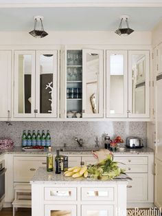 Trick the Eye...adding mirrors to kitchen cabinet doors to give the illusion of more space.