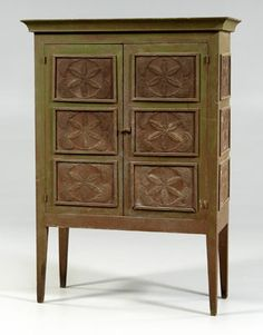 Georgia paint-decorated pie safe, yellow pine throughout in early green and reddish-brown painted surface, two doors, each with three compass star punched tins opening to shelved interior, case sides each with three similar tins, tapered square legs, attributed to Franklin County, Georgia, 19th century, 64-1/2 x 46-1/4 x 19-3/4 in.